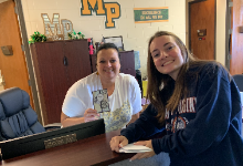 Key Club member giving Carrie Whitaker a Thank You card for World Teacher's Day
