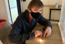 Student showing that his electrical component works!