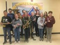 Junior High students pose with musical instruments