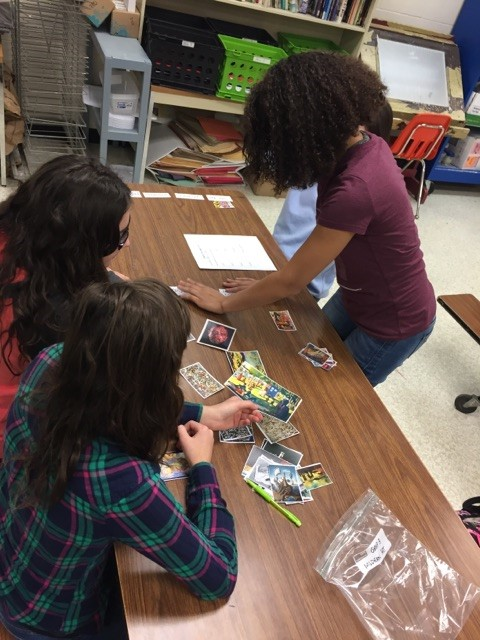 Students collaborate in artwork sorting activity