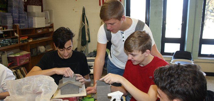 Ceramics students working on slab houses