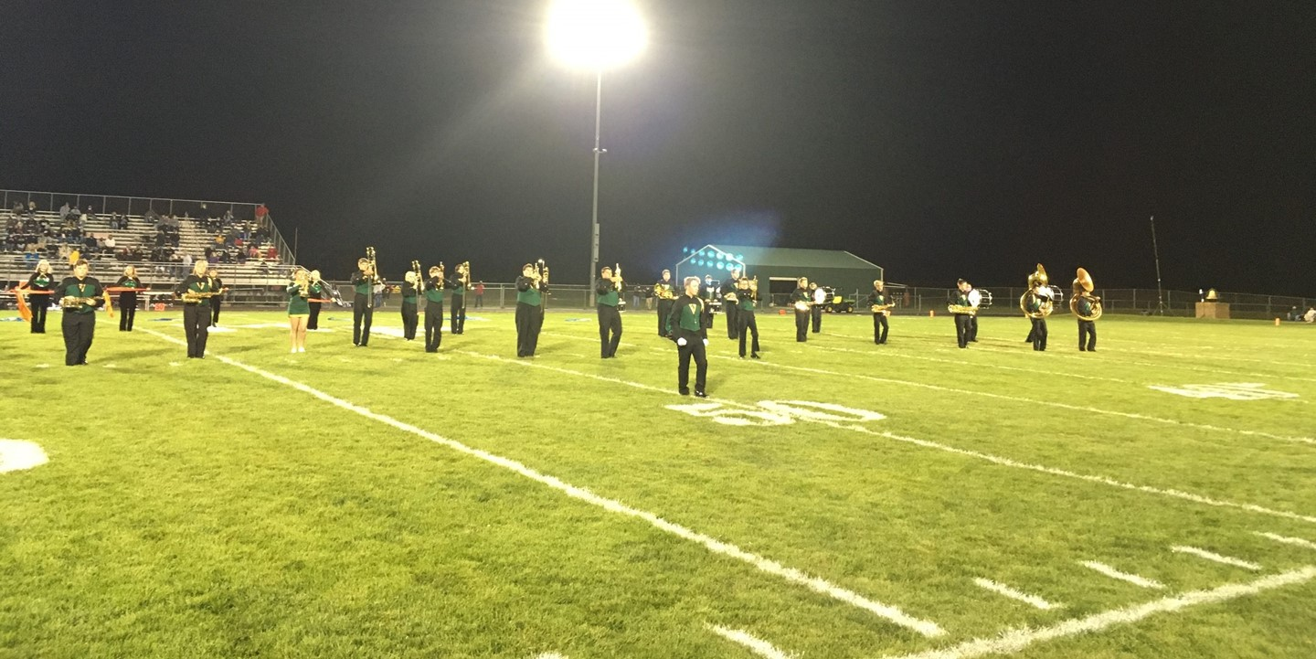 Marching band on the field performing