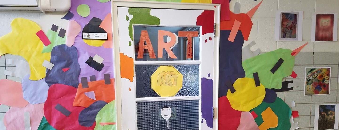 The art door from the K-6 building decorated with lots of color