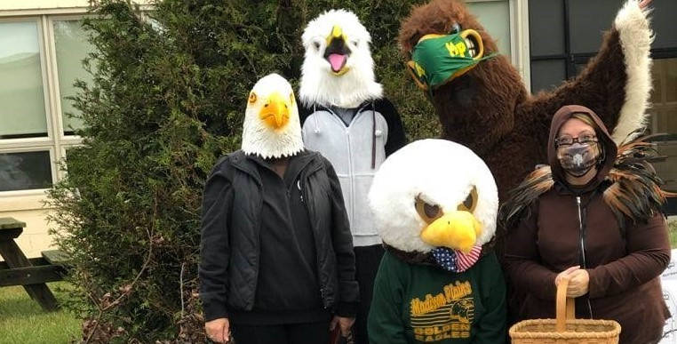 Central office staffed dressed as eagles for Halloween